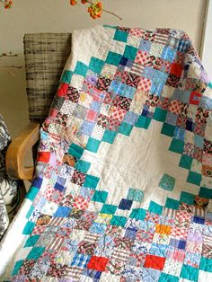 postage stamp patchwork quilt - love the organizing turquoise and white space