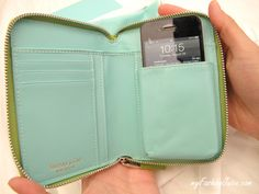 Whats in a Tiffany Wallet? a place for your credit cards,license, $$ and iPhone!