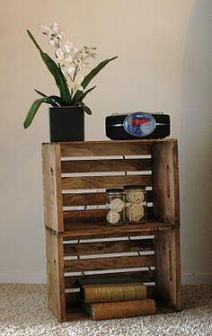 This looks like my nightstand, only mine is two old peach crates or something stacked next to each other instead of on top, and with multiple shelves. I really like mine!