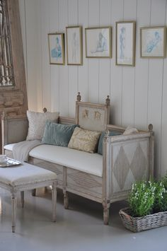 Love the framed drawings over the vintage settee, the old door leaning against the wall.