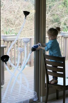 Funnels, Tubes, and Colored Salt - doubles as a window marble run! FUN AT HOME WITH KIDS