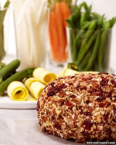 Martha's Cheddar Cheese Ball - I mean, seriously, who doesn't love a good ball o' cheese!? Leave it to Martha Stewart herself to come up with the best one out there!   Perfect for all your holiday parties! Yum!- I wonder what it tastes like with the mango chutney in it?  Interesting twist. :-/