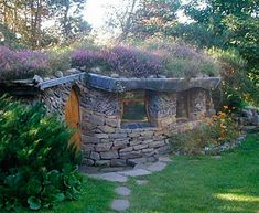 I want to live here.   Stone cottage with living roof.