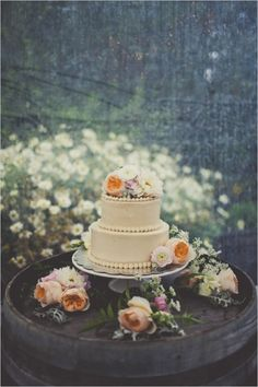 simple white wedding cake with fresh floral accents