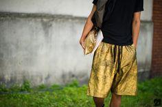 Paris Mens Fashion Week Street Style - VOLUMIZED GILT BERMUDAS. I really really want these...