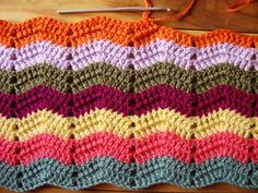 Looking for a fun variation on the basic ripple crochet afghan? The Malibu Ripple Afghan is the perfect ripple pattern to try. Complete with a graphic chart and a few photos to help you along, you'll love the way this ripple afghan turns out. Great for fun and colorful summer days, this ripple afghan is as beachy as can be.