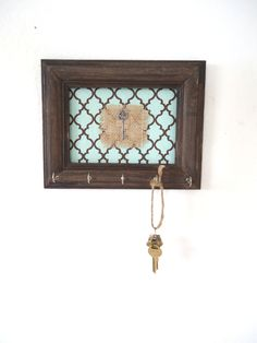 This is awesome!  How cute it would be to put the key from your first home in the frame to make it extra special!