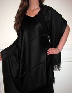 Black pashminas women are passionate about  them. Elegant black dresses gowns and black pashminas are a big style statement.