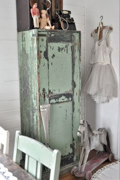 Chippy Green Cupboard...carved horse on wheels...vintage treasures. I love having these unusual items around the home and guesthouses