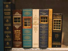 urban fairy houses made out of book spines