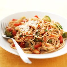 Whole grain #pasta, high-fiber beans, and no-salt-added diced tomatoes make this spaghetti a heart-healthy dinner.