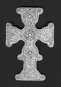 Tullylease Cross - considered the finest Early Christian cross slab in Ireland, this 8th century artifact is found in the ruins of the monastery founded by St. Berichter in County Cork.  The cross consists of a labyrinth of key patterns & several bosses & has been compared to metal processional crosses as the possible inspiration for this kind of design in stone.