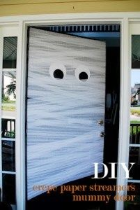 Easy Halloween DIY Decor - Mummy Door made with streamer, stick some eyes on him & he's done (: