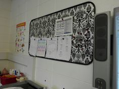 Teachers magnetic board!  Using an oil drip pan for 10 bucks at walmart and some wrapping paper, I now have a place to put important papers and calendars!