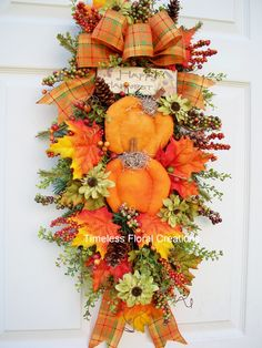Pumpkin swag decorating http://www.timelessfloralcreations.com/