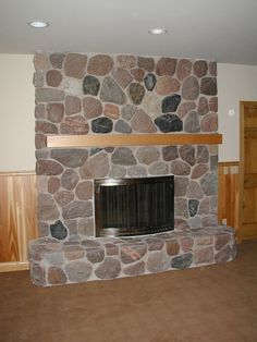 A split stone fireplace in one of our homes. Please visit our boards for more photos. - John - http://pinterest.com/northtwinbuild/