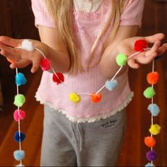 lorajean's magazine: how to make a pom pom garland.