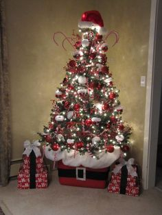 great decorating idea...Use a Rubbermaid container to sit your Christmas tree in.