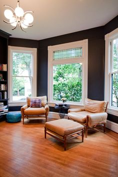 love the white trim against the charcoal walls.