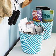 Decorated tin buckets become an inexpensive storage solution. More storage ideas on a dime: http://www.bhg.com/rooms/home-office/storage/cheap-home-office-storage-ideas/?socsrc=bhgpin071812tinbucketstorage