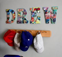 Must do this for Dray's room!  Old comic books and letters from crafts store... He needs this for his hats.