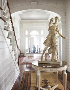 Veranda Magazine - Antique collector's entry hall with statue of Diana amongst other treasures.