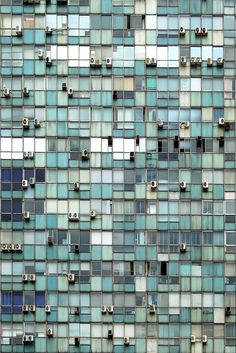 reality of urban existence + repetition + colour