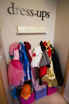 dress-ups on hooks, bins underneath for accessories - see link for big pic (also a article about kids stuff in small spaces)