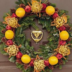 Colonial Christmas | Give your holiday a colonial feel by using wreaths embellished with colorful fresh or dried natural materials. Plants such as holly, magnolia, mistletoe, pine, ivy, and fir were common in the 18th century. | SouthernLiving.com