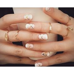 manicure with skinny gold custom decals