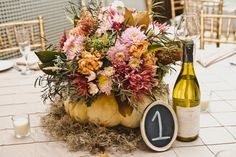 Rustic pink and orange white pumpkin centerpiece- great for a Fall wedding! photo by BG Productions