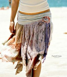 DIY Gypsy-Chic tattered skirt- the waist band is made from the bottom of a tee shirt- sew on an eclectic mix of raw edge fabric strips for a one of a kind playful piece!