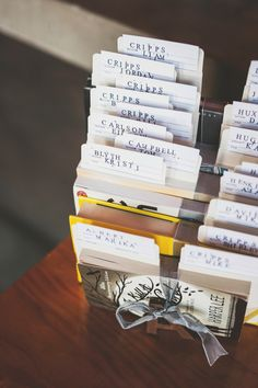 library cards tucked into books as escort cards, photo by Ameris Photography http://ruffledblog.com/victoria-art-gallery-wedding #weddingideas #seatingchart #escortcards