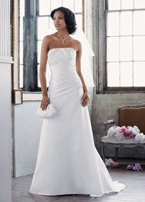 Satin A-line with pleated bodice, and beaded lace appliques. Sweep train. Available in White. To preserve your wedding dreams, try our Wedding Gown Preservation Kit.A train that just brushes the floor.A decorative fabric design or lace cutout that is applied to another fabric such as a dress, veil or shoes.A dress with a fitted bodice that gradually flares from the waist. A-line styles are flattering for all women.A smooth fabric often used in bridal gown design because of its exquisite drape.