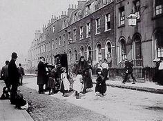 Organ grinder attracts a crowd in a Lambeth street, 1893.