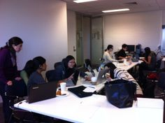 Participants working hard on their projects at the International Women's Hackathon in Australia!