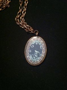 "Mirror bird necklace.  On 30"" copper necklace.  $17"