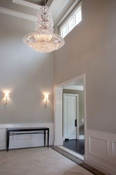 Paint color on both wall and ceiling are Fine Grain (DE6213) by Dunn Edwards.  The trim color is light beige (DE6211) also by Dunn Edwards.