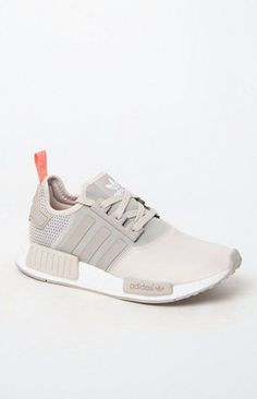 adidas combines modern streetwear style with innovative technology in the Women's NMD_R1 Brown Low-Top Sneakers. Fashioned in a brown hue, these low-top sneakers feature a soft suede and peached jersey upper, durable and shock-resistant angled boost??? midsole with built-in EVA plugs, and bold archival details. boost???'s energy-returning properties keep every step charged with an endless supply of light, fast energy Premium suede and peached jersey upper Overlock deco stitching...