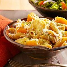 In this braised cauliflower and squash penne pasta recipe, we cook the pasta and vegetables in broth rather than water to make this warming vegetarian pasta extra flavorful.