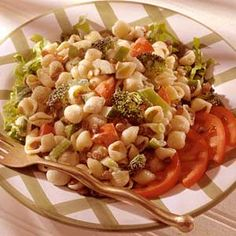 A refreshingly zippy mustard dressing perks up this low-fat meatless main-dish salad.