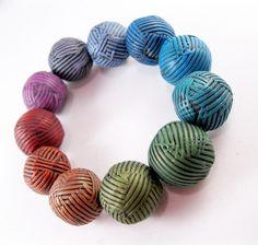 Rebecca Watkins - easy flickr tute starts here: http://www.flickr.com/photos/34443858@N07/5834577887/in/photostream  #Polymer #Clay #Tutorials