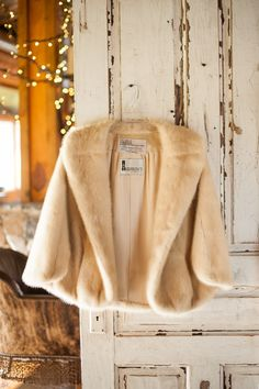 Fur shrug for a winter wedding.    Photography by A.J. Dunlap Photography  Read more - http://www.stylemepretty.com/north-carolina-weddings/raleigh/2014/02/07/raleigh-wedding-at-the-pavilions-at-the-angus-barn/