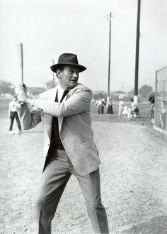 """John Wayne """"The Duke"""" plays baseball."""