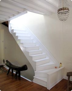painted and open wooden staircase