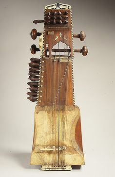 *Sarangi (1900) ~ A beautiful full sound and a close proximity to the melodic flexibility of the human voice make the sarangi the most important bowed instrument of classical Hindustani music of northern India and Pakistan. A rigid horsehair bow (not shown) rhythmically sounds the gut melody strings that cross over an ivory elephant-shaped bridge (bara ghurac).