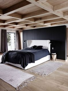 black wall and wood ceiling in bedroom