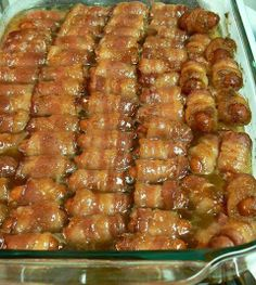 Bacon-Wrapped Smokies w/ Brown Sugar  1 lb Bacon  1 lb Lil' Smokies (small sausages) 1 stick Butter 2 c. Brown Sugar  Preheat oven to 375F Cut bacon into thirds. Wrap each smokie. Place wrapped smokies in single layer in baking dish. Melt  butter and cup of brown sugar, stir until mixed well. Pour butter/brown sugar mix over top. Sprinkle other cup of brown sugar evenly over top. Bake 15-20 mins, then turn heat up to 400F for ~ 5 mins until bacon is crispy.