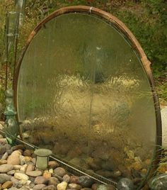 Glass Table Top Turned into a garden water fountain.  Get 5 more Creative Ideas for Upcycled Water Features