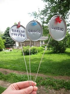 Super Cute Garden Markers made from orange juice concentrate lids! Love this!!  via Notes from the Heartland juic concentr, juic lid, craft, orang juic, plant markers, garden markers, gardens, garden idea, orange juice